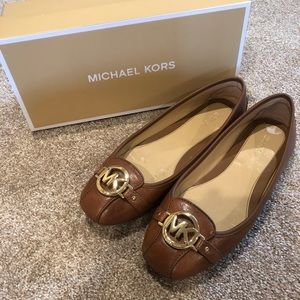 Michael Kors brown leather flats with gold emblem